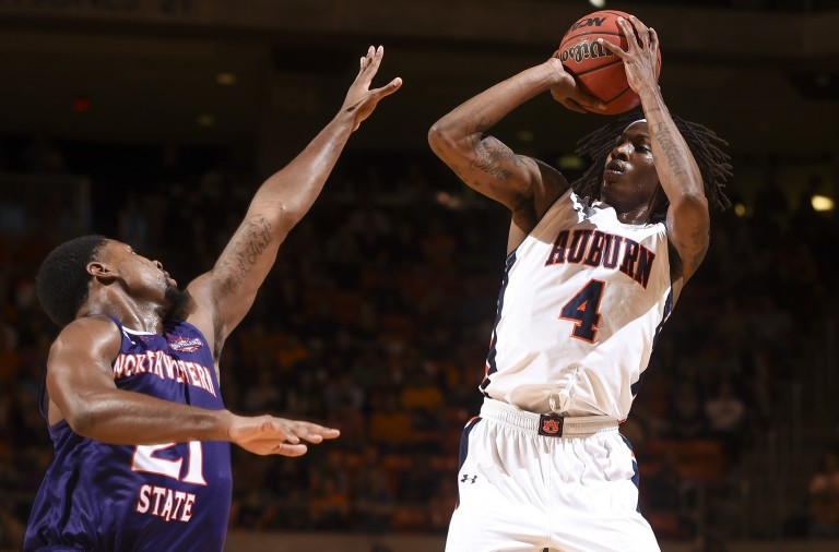 T.J. Dunans (4) shoots a 3-pointer.  Northwestern State vs. Auburn in Auburn, Ala. on Friday, Nov. 27, 2015.  Zach Bland/Auburn Athletics