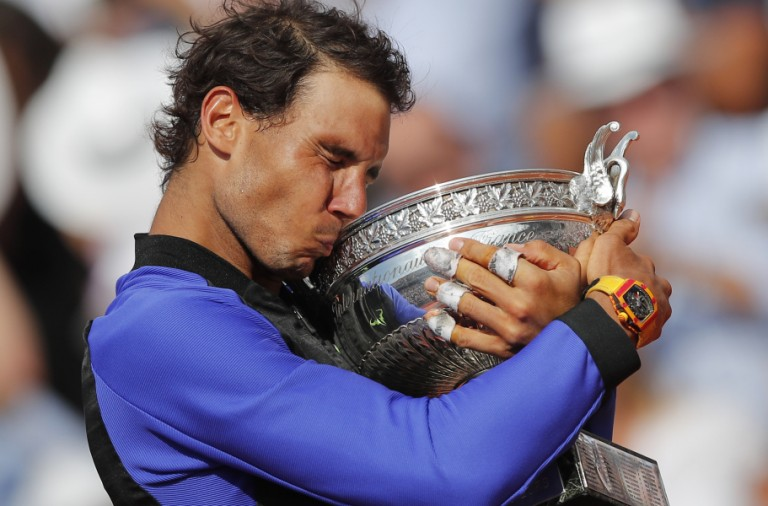 Spain's Rafael Nadal celebrates winning his tenth French Open title against Switzerland's Stan Wawrinka in three sets, 6-2, 6-3, 6-1, during their men's final match of the French Open tennis tournament at the Roland Garros stadium, in Paris, France, Sunday, June 11, 2017. (AP Photo/Christophe Ena) ORG XMIT: PDJ201