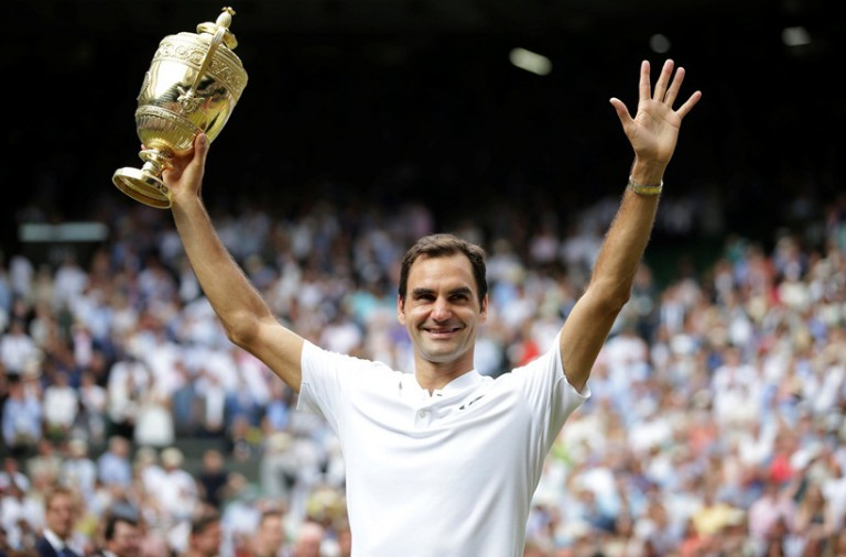 Tennis - Wimbledon - London, Britain - July 16, 2017   Switzerland's Roger Federer poses with the trophy as he celebrates winning the final against Croatia's Marin Cilic    REUTERS/Daniel Leal-Olivas/Pool