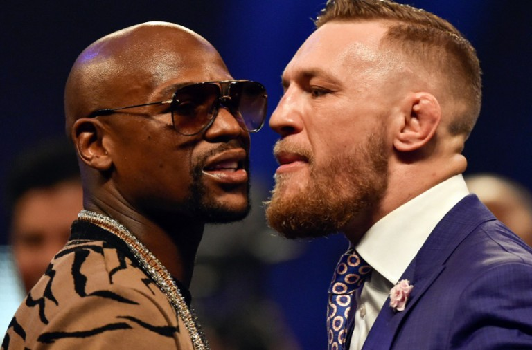 Jul 14, 2017; London, United Kingdom;  Conor McGregor and Floyd Mayweather face off during a world tour press conference to promote the upcoming Mayweather vs McGregor boxing fight at SSE Arena. Mandatory Credit: Steve Flynn-USA TODAY Sports