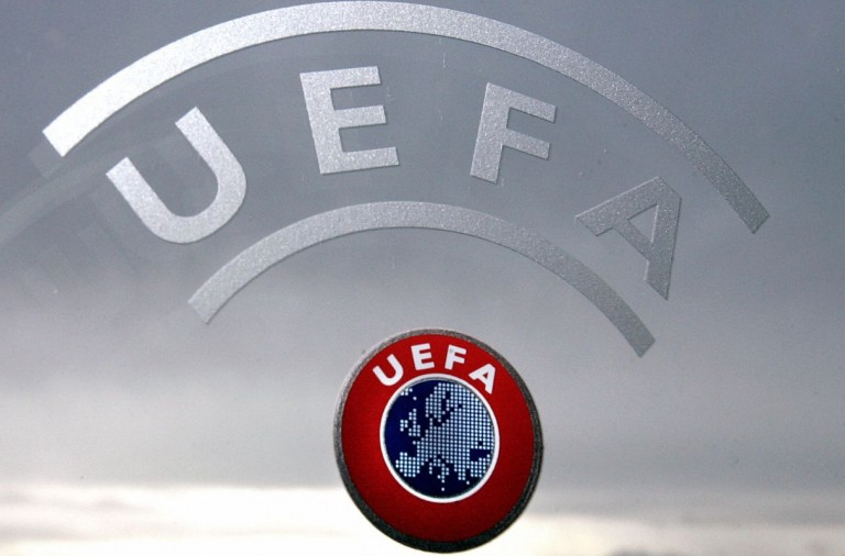 Nyon, SWITZERLAND:  A UEFA logo is seen with Geneva Lake and Alps as background 08 December 2006 during a press conference closing a two days Executive committee meeting of the European football federation at the headquarters in Nyon. AFP PHOTO / FABRICE COFFRINI  (Photo credit should read FABRICE COFFRINI/AFP/Getty Images)