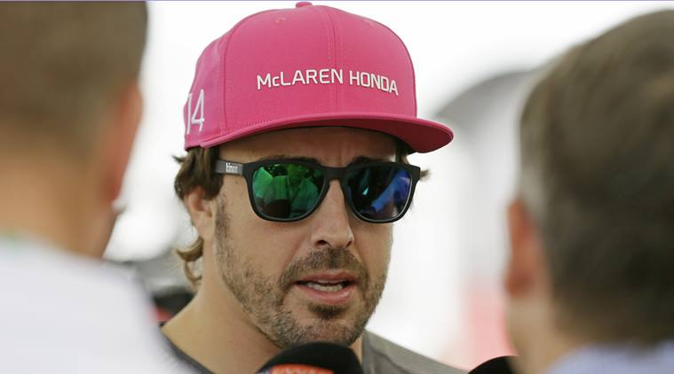 McLaren driver Fernando Alonso, of Spain, responds to a question during a news conference for the Formula One U.S. Grand Prix auto race at the Circuit of the Americas, Thursday, Oct. 19, 2017, in Austin, Texas. (AP Photo/Tony Gutierrez)