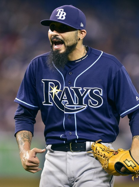 Tampa Bay Rays relief pitcher Sergio Romo (54) reacts after getting Toronto Blue Jays right fielder Jose Bautista, not shown, out on a pop fly during seventh inning American league baseball action in Toronto on Monday, Aug. 14, 2017. (Frank Gunn/The Canadian Press via AP)