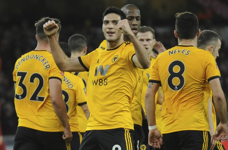 Wolverhampton's Raul Jimenez celebrates after he scores his sides first goal during the English FA Cup third round soccer match between Wolverhampton Wanderers and Liverpool at the Molineux Stadium in Wolverhampton, England, Monday, Jan. 7, 2019. (AP Photo/Rui Vieira)