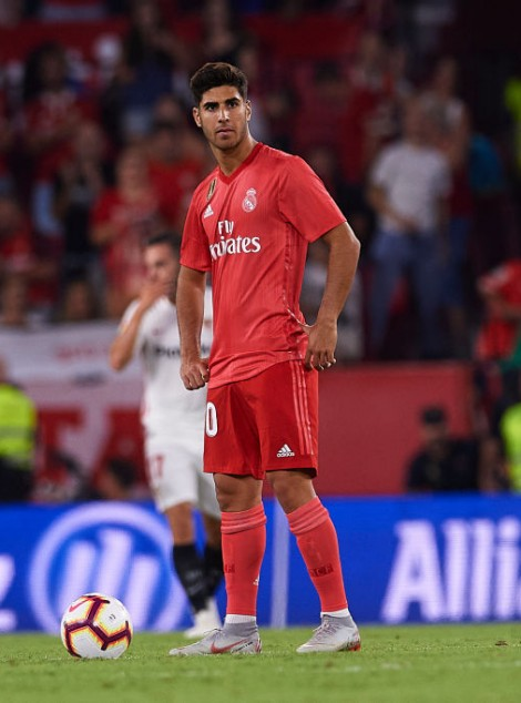 SEVILLE, SPAIN - SEPTEMBER 26:  Marco Asensio  of Real Madrid CF reacts after being scored during the La Liga match between Sevilla FC and Real Madrid CF at Estadio Ramon Sanchez Pizjuan on September 26, 2018 in Seville, Spain.  (Photo by Aitor Alcalde/Getty Images)