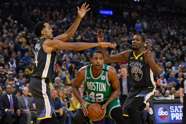 Golden State Warriors' Shaun Livingston (34) and Golden State Warriors' Kevin Durant (35) guard Boston Celtics' Al Horford (42) during the first quarter of their NBA game at the Oracle Arena in Oakland, Calif. on Saturday, Jan. 27, 2018. (Jose Carlos Fajardo/Bay Area News Group)