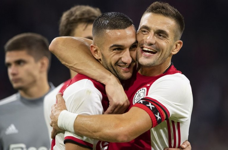 Ajax Amsterdam's Serbian forward Dusan Tadic (R) and Ajax Amsterdam's Moroccan midfielder Hakim Ziyech celebrate after winning the UEFA Champions League third preliminary round football match between Ajax Amsterdam and PAOK Saloniki, on August 13, 2019 in Amsterdam, The Netherlands. (Photo by Olaf KRAAK / ANP / AFP) / Netherlands OUT        (Photo credit should read OLAF KRAAK/AFP/Getty Images)