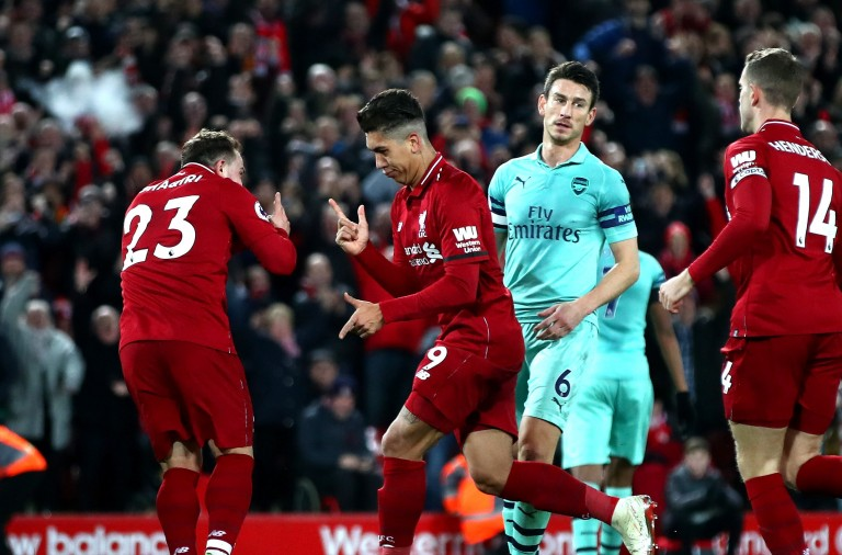 LIVERPOOL, ENGLAND - DECEMBER 29:  Roberto Firmino of Liverpool celebrates with Xherdan Shaqiri after scoring his sides fifth goal during the Premier League match between Liverpool FC and Arsenal FC at Anfield on December 29, 2018 in Liverpool, United Kingdom.  (Photo by Clive Brunskill/Getty Images)