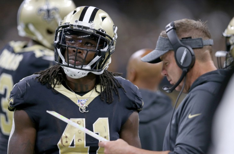 Oct 6, 2019; New Orleans, LA, USA; New Orleans Saints running back Alvin Kamara (41) and head coach Sean Payton confer during a timeout in the second half against the Tampa Bay Buccaneers at the Mercedes-Benz Superdome. Mandatory Credit: Chuck Cook-USA TODAY Sports