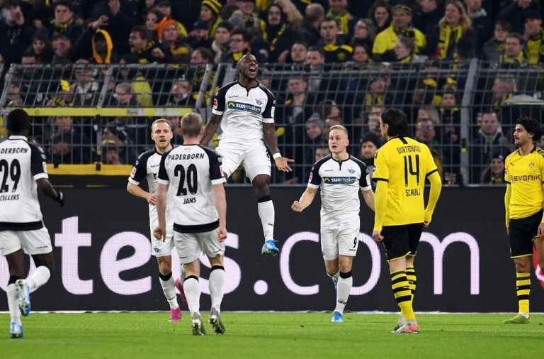 DORTMUND, GERMANY - NOVEMBER 22: Streli Mamba of Sport-Club Paderborn celebrates scoring his teams first goal of the game with team mates during the Bundesliga match between Borussia Dortmund and SC Paderborn 07 at Signal Iduna Park on November 22, 2019 in Dortmund, Germany. (Photo by Jörg Schüler/Bongarts/Getty Images)